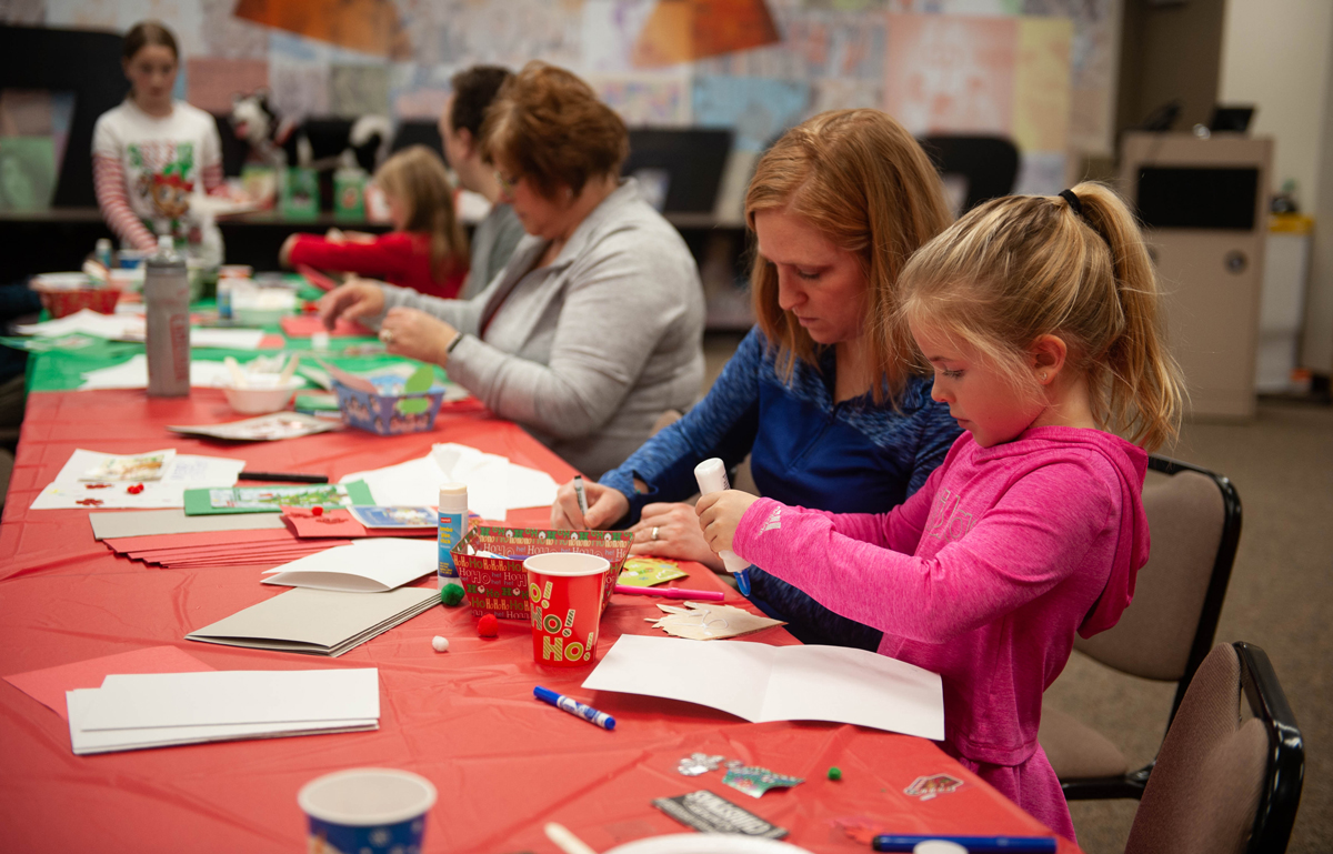 Dupaco staff and their families make holiday cards for Dubuque area nursing homes on Dec. 1, 2018 at the Pennsylvania Avenue branch in Dubuque, Iowa. (M. Blondin/Dupaco photo)