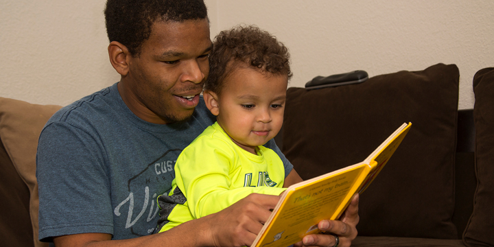Dupaco Member Damian Janisch Reads To His Son, Xzavier, In Their Dickeyville, Wis., Home. Thanks To Swift Action By His Financial Cooperative, Janisch's Money—and His Dupaco Accounts—were Secured When He Became A Victim Of Identity Theft. (S. Gassman Photo)