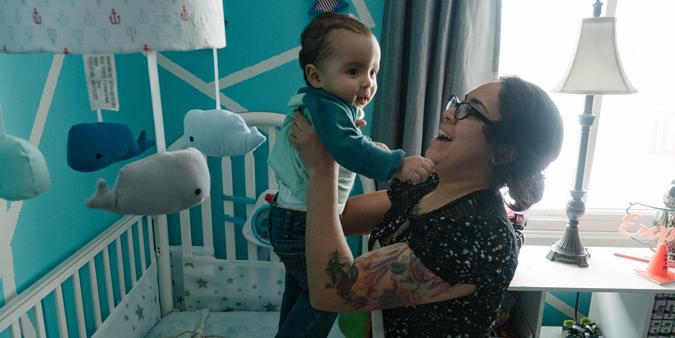 Dupaco member Priscilla Delao picks up son Eugene from crib