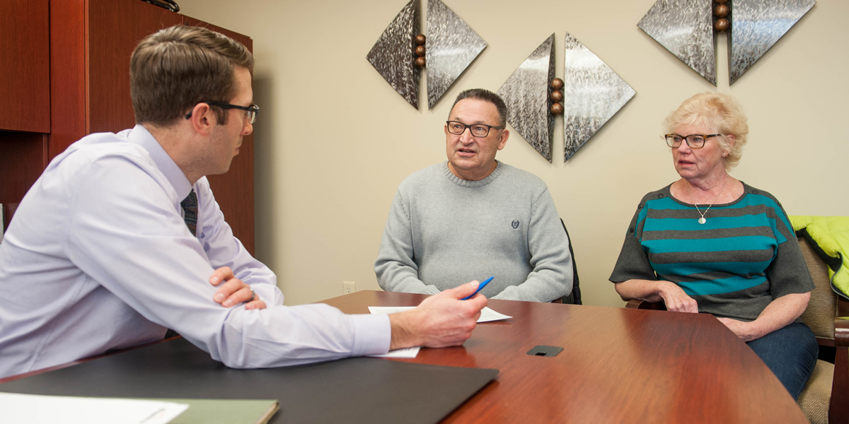 Dupaco Members Wayne And Mary Konrardy Meet With Michael Poppen From Dupaco Financial Services