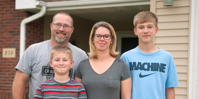 Dupaco Members Jason And Cara Benn, With Sons Griffin (right) And Landin, Settle Into Their New Home In Peosta, Iowa. (M. Blondin/Dupaco Photo)