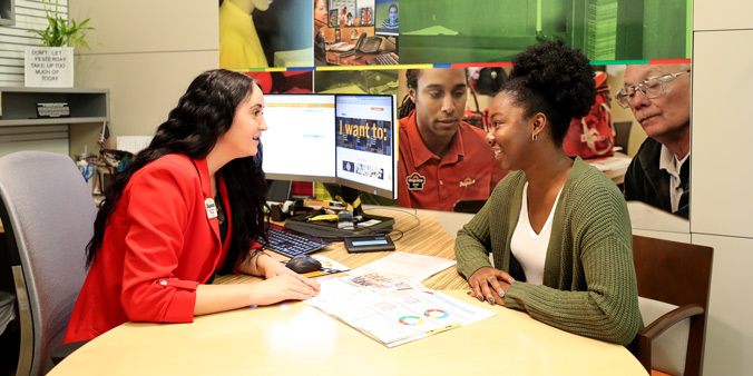 Dupaco's Majda Karajic (left) Catches Up With Member Porcha Fields On Sept. 12 At Dupaco's Mullan Avenue Branch In Waterloo, Iowa. (B. Pollock Photo)