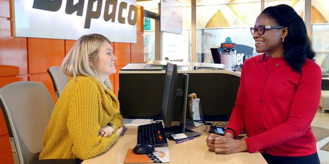 Member ReShonda Young, Of Waterloo, Iowa, Visits With Dupaco's Chloe Brown At The Mullan Branch In Waterloo, Iowa. (B. Pollock Photo)