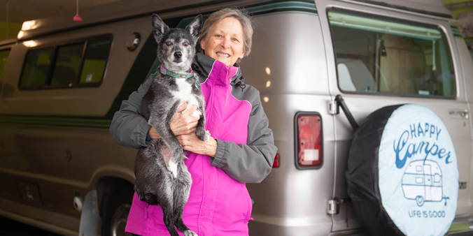 Dupaco Member Sue Olsen, Of Dubuque, Iowa, Said Dupaco's Fraud Services Team Listened To Her Concerns About Buying A Campervan She Had Agreed To Purchase Sight Unseen—and Offered Her A Way Out Of The Sale. Ultimately, Olsen Bought The Vehicle, But Is Grateful For A Credit Union That Always Has Her Back. Also Pictured: Olsen's Dog, BB. (M. Blondin/Dupaco Photo)