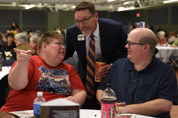 Dupaco CEO Joe Hearn (center) Chats With Members Renee And Scott Kehoe During The 71st Annual Dupaco Membership Meeting On March 1, 2020 In Peosta, Iowa.