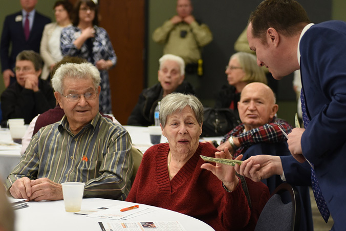 Dupaco Board Member Andy Schroeder Hands Out Cash Winnings During The Door Prizes At The 71st Annual Dupaco Meeting Of The Membership On March 1, 2020, At The Peosta Community Centre In Peosta, Iowa.
