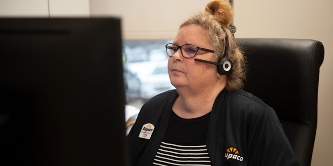 Dupaco Insurance Services' Chris Rogers works on her computer at Dupaco's Pennsylvania Avenue branch in Dubuque, Iowa. (M. Blondin/Dupaco photo)
