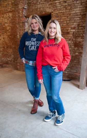 Sisters Marah Odgers and Marissa Hoffmann, co-owners of The Midwest Girl, pose for a photo on Jan. 22 as they check out their new store location in Dubuque, Iowa. The store will open in the Millwork District in spring 2020. (M. Blondin/Dupaco photo)