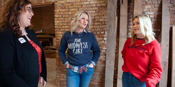 Dupaco's Tanya Moore (left) Visits With Sisters Marah Odgers And Marissa Hoffmann, Co-owners Of The Midwest Girl, On Jan. 22 As They Check Out Their New Store Location In Dubuque, Iowa. The Store Will Open In The Millwork District In Spring 2020. (M. Blondin/Dupaco Photo)