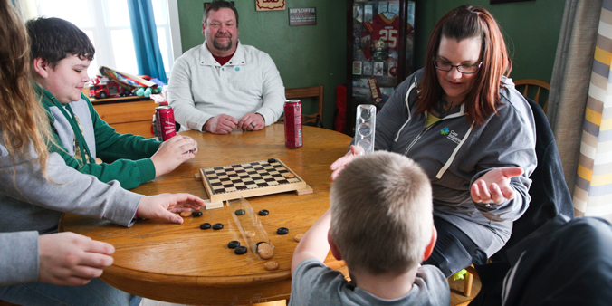 Dupaco Members Michael And Jen Graham Play A Game With Their Three Children At Their Home In Villisca, Iowa. (A. Mehl Photo)