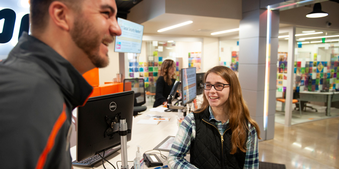 Emily, First-place Winner Of The Dupaco Great Credit Race, Visits With Her Race Coach, Noah Kachelski, At The Pennsylvania Avenue Branch In Dubuque, Iowa. (M. Blondin/Dupaco Photo)