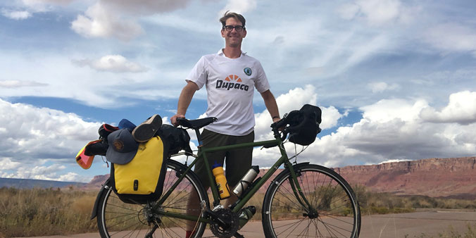 George Hofheimer, Chief Knowledge Officer Of The Credit Union Think-tank Filene Research Institute, In Oct. 2018 Represents Dupaco And Union Dubuque F.C. During A 425-mile Solo Bike Ride From St. George, Utah To Phoenix, Arizona. Hofheimer—a Collegiate Soccer Standout—wore The Jersey Sent To Him By His Friends At Dupaco. (Photo By George Hofheimer)
